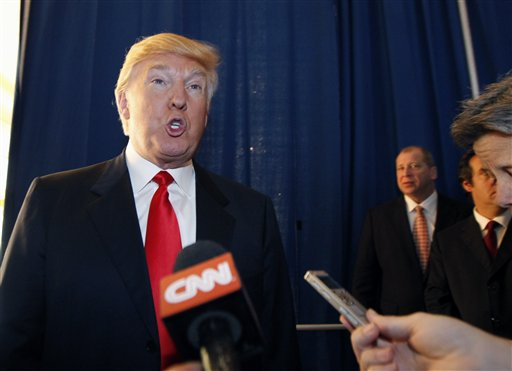 Donald Trump talks to reporters today prior to a news conference in which he announced his endorsement of Mitt Romney for president.
