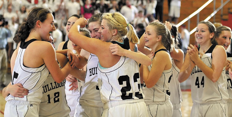 The Hall-Dale girls' basketball team celebrates after beating Waynflete, 43-36, to earn a spot in the Class C state championship game against Central.