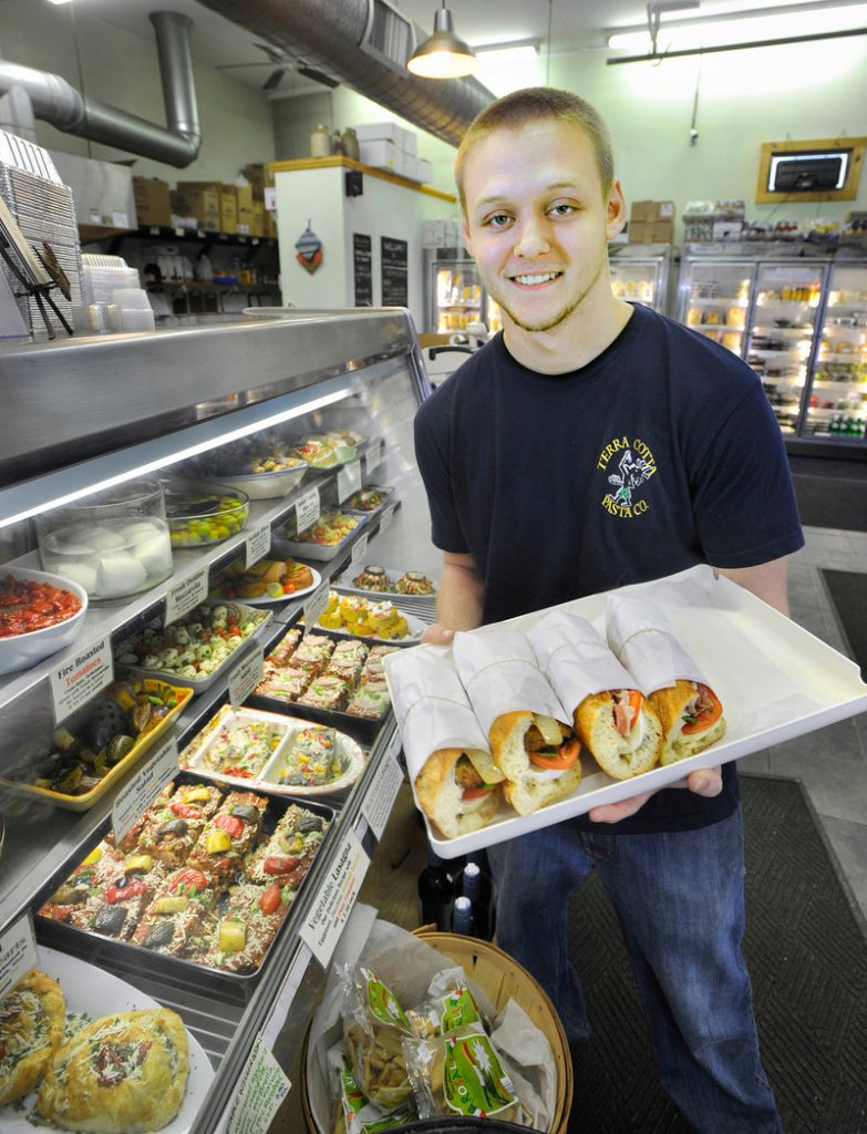 Tom Wiley with some of the daily special sandwiches at Terra Cotta Pasta.