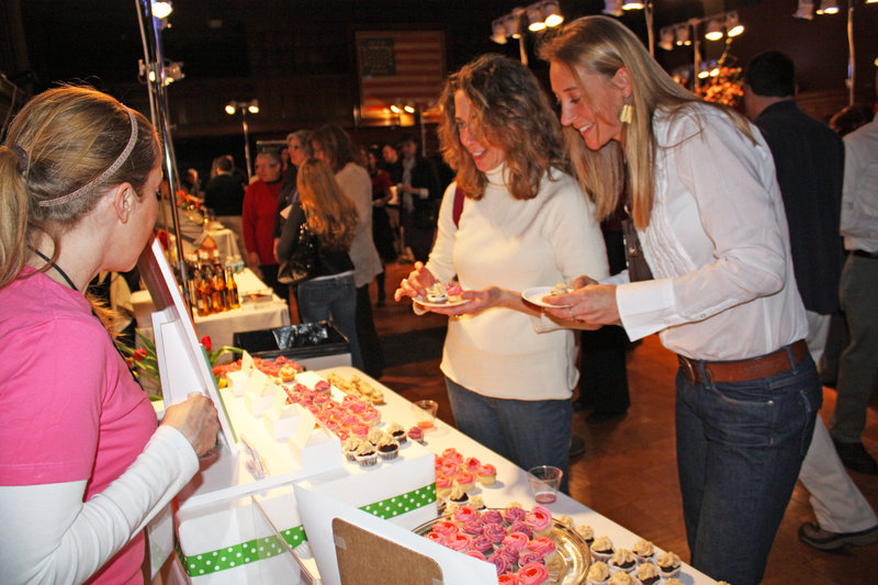 Stephanie O'Neil of Tulips Cupcakery shares samples with Francesca Kerr and Patience Cleveland at last year's Signature Event.
