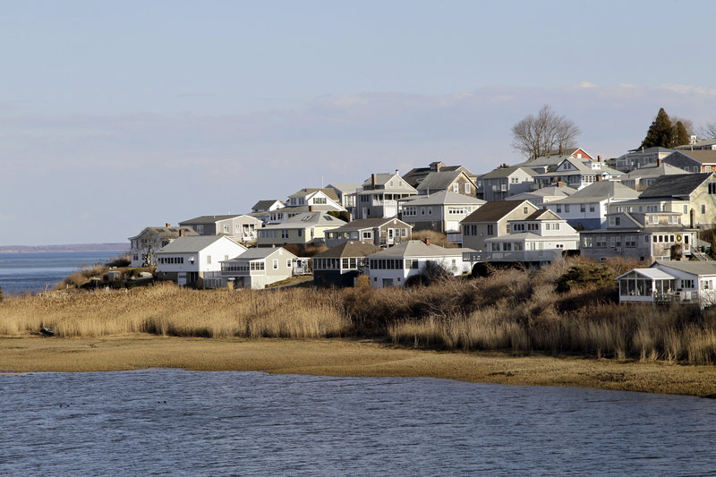 Houses are shown on Little Neck in Ipswich, Mass. The dying wish of William Payne, one of the state's earliest settlers, created the nation's oldest charitable trust and eventually led tenants to build 167 cottages on this land he left for the seaside city.