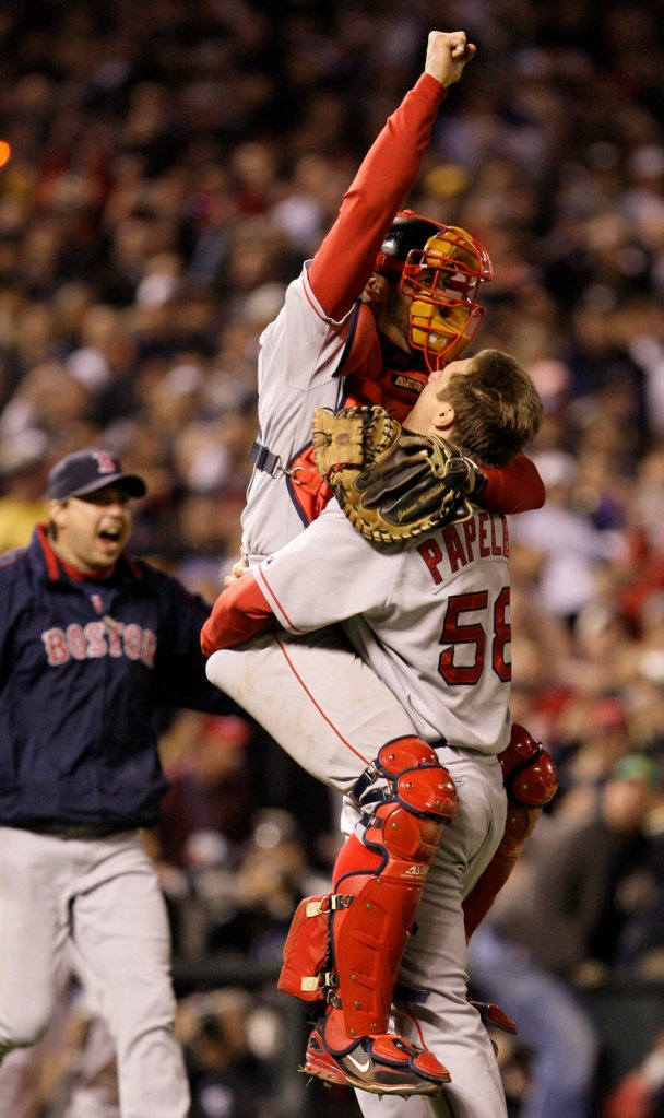 Three years later … it's time to celebrate again as Jason Varitek jumps into the arms of closer Jonathan Papelbon after another Series sweep.