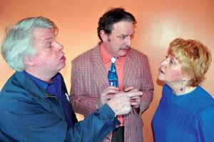 """NICK BUCK, Denis Walsh and Nancy Durgin rehearse """"Dr. Fish,"""" one of four short plays that the Lincoln Community Theater will perform as part of """"Sex in the Sixties: An Evening of Four- Play(s)"""" at Lincoln Theater in Damariscotta. The production opens tonight. Performances run through March 11."""