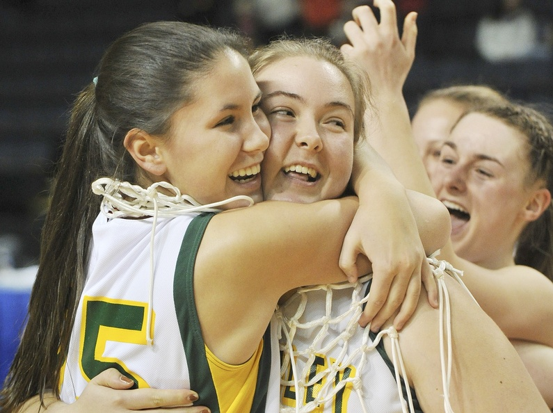 Mary Leasure, left, and Kate Liziewski, a co-captain, are seniors who didn't play that much on McAuley's talent-laden team this season, But when the time came to cut down the nets after the state final, their teammates insisted in a classy move that they do the honors. And they did it in style.