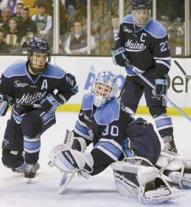 UMAINE GOALTENDER Dan Sullivan (30) and teammates Stu Higgins (22) and Will O'Neill (27) react as the puck goes in the net for a goal by Boston College's Pat Mullane in the second period of an NCAA college Hockey East final in Boston on Saturday.