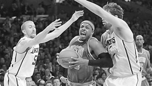BOSTON CELTICS forward Paul Pierce drives between Los Angeles Lakers guard Steve Blake (5) and forward Pau Gasol, right, in the second half of an NBA basketball game on Sunday in Los Angeles. The Lakers won 97-94.