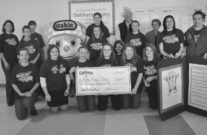 Bill Bennett and Althea Bennett McGirr, along with Oakie, recently joined students at Bath Middle School in the presentation of a $4,000 grant to support programs to improve healthy eating and increase physical activity. (Courtesy of Oakhurst Dairy)