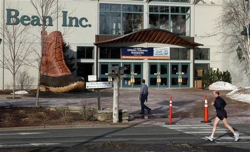 A jogger passes by the entrance to the L.L. Bean retail store in Freeport. (