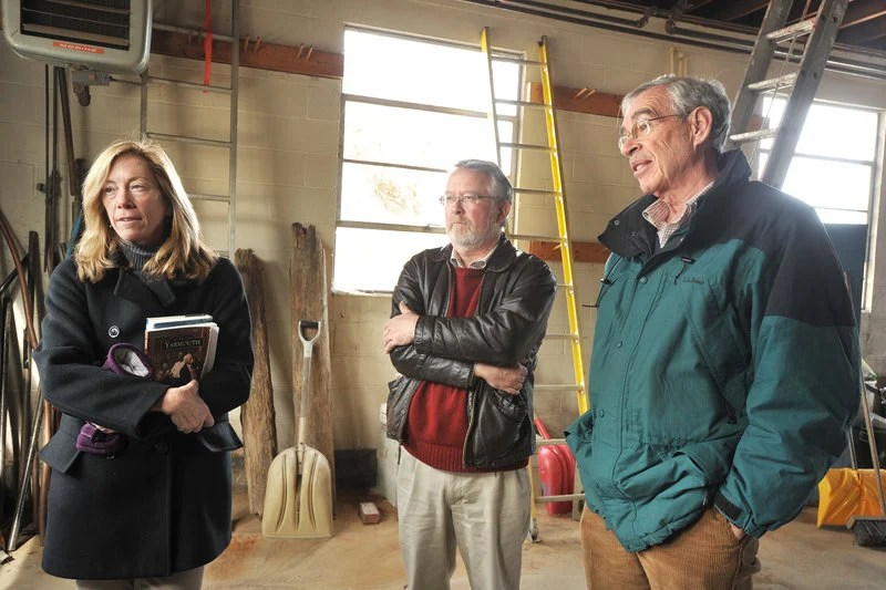 Yarmouth Historical Society officials Amy Thompson, Michael Chaney and John Palmer, standing this week in the former town water district building on East Elm Street, discuss plans for developing a new history center there.