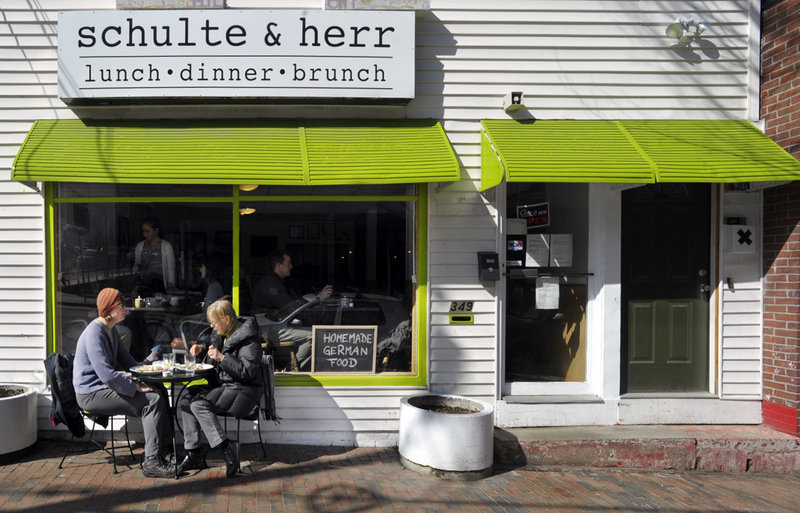 Annika Black of Bridgton, left, and her mother, Marlies Reppenhagen of Portland, dine on Schulte & Herr's homestyle German food outside on a mild March day. The restaurant recently added dinner to its brunch and lunch offerings.