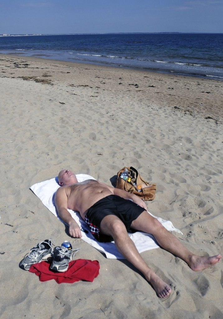 Rich Breton of Saco was able to get in some sunbathing at Bayview Beach in Saco on March 19.