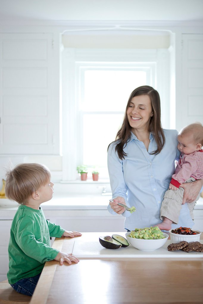 Amanda Bell, who owns Biddeford Saco Boot Camp, eats lunch with her children Simon, 2 1⁄2, and Grayson, 5 months, in her Biddeford kitchen.