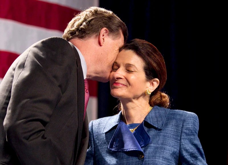 Sen. Olympia Snowe, R-Maine, gets a kiss from her husband, John R. McKernan, following her speech at the Maine Republican State Convention on Sunday.