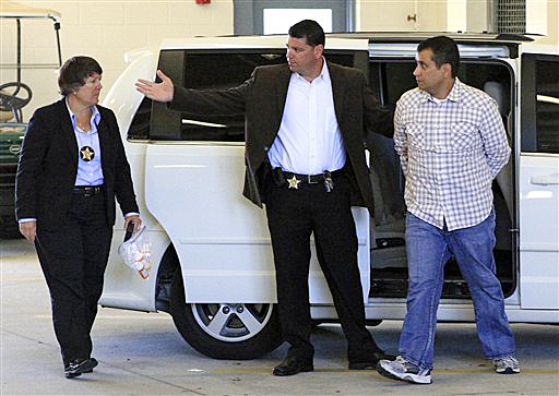 George Zimmerman, right, returns to the John E. Polk Correctional Facility in Sanford, Fla., today. Zimmerman is charged with second-degree murder in the shooting of Trayvon Martin.