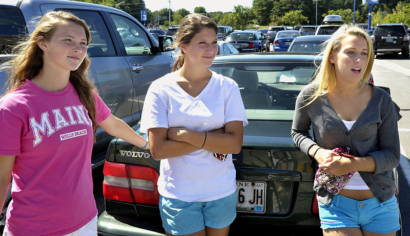 Eden Monsen, 17, left, Maddie Richardson, 17, and Danielle Kane, 18, all from Brunswick, give their opinions on the new driving laws during a shopping trip at the Maine Mall Wednesday.