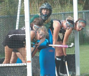 BRUNSWICK HIGH SCHOOL field hockey players Lillian Kjellman, Michelle Ingram, Taylor Godbout, Olivia LeRoy and goaltender Sydney Escoe prepare to defend against a Lewiston penalty corner in a recent Kennebec Valley Athletic Conference contest at Lewiston.
