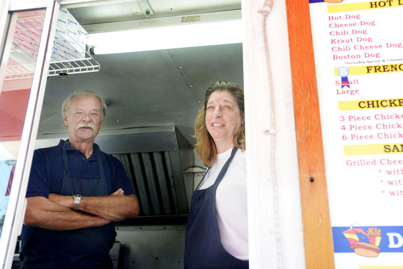 Vaughn Mason and Paula Rosander of Hot Digity Dog talk Wednesday about an alleged prostitution operation in Kennebunk. Mason's lunch van is located in a parking lot on York Street where Alexis Wright operated a Zumba studio.