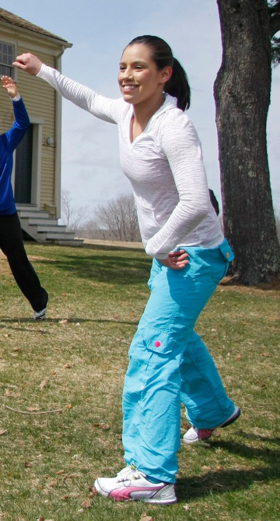 Alexis Wright demonstrates Zumba at a festival in Wells last year. According to a police affidavit, searches of Wright's office yielded evidence of prostitution.