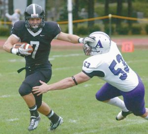 BOWDOIN COLLEGE running back Greg Pierce (7) eludes Amerhst tackler Travis Dickenson (53) and heads downfield during Saturday's footbal game in Brunswick.
