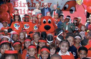 THIS IMAGE released by Scholastic shows first-graders celebrating Clifford the Big Red Dog's 50th anniversary, along with his creator Norman Bridwell, center rear, his daughter Emily Elizabeth, left, and Scholastic CEO Dick Robinson at Scholastic's headquarters in New York, Sept. 24.