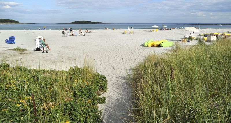 In this July, 27, 2011 file photo, a small public path leads to a small section of public beach at Goose Rocks Beach in Kennebunkport.