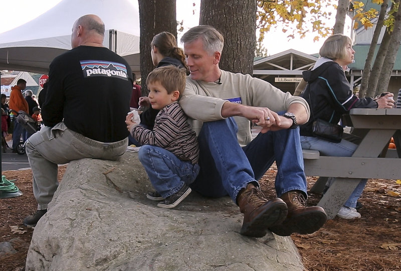 Charlie Summers takes a break with his son Thomas at the Camp Sunshine Pumpkin Festival at L.L. Bean in Freeport. They also did some pumpkin bowling and imaginary fishing.