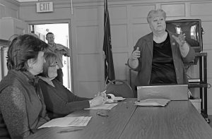 CITY CLERK MARY WHITE INSTRUCTS ballot counters how to do their duties Thursday morning in City Hall, as Ann Spencer and Sally Vose watch.