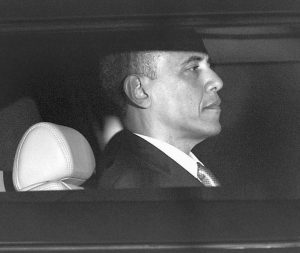PRESIDENT BARACK OBAMA is seen through the window of a limo Wednesday as he returns to the White House for the first time since his victory on Election Day.
