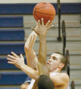 UNIVERSITY OF SOUTHERN MAINE point guard Alex Kee of Bath in action.