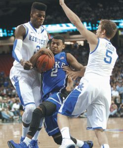 DUKE GUARD Quinn Cook (2) is fouled as he drives between Kentucky's Nerlens Noel (3) and Jarrod Polson (5) in the first half of an NCAA college basketball game in Atlanta on Tuesday.