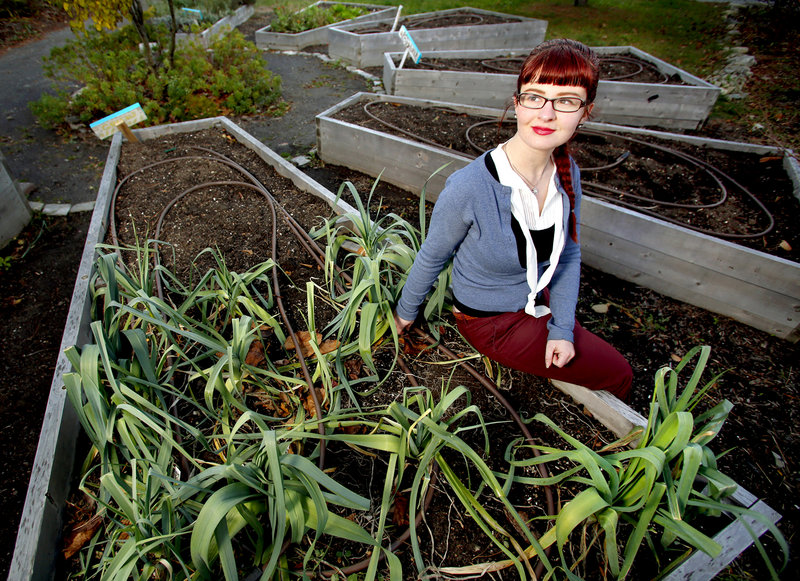 Holly Seeliger, elected to represent District 2 on the school board, poses at the Reiche Elementary School Community Garden.