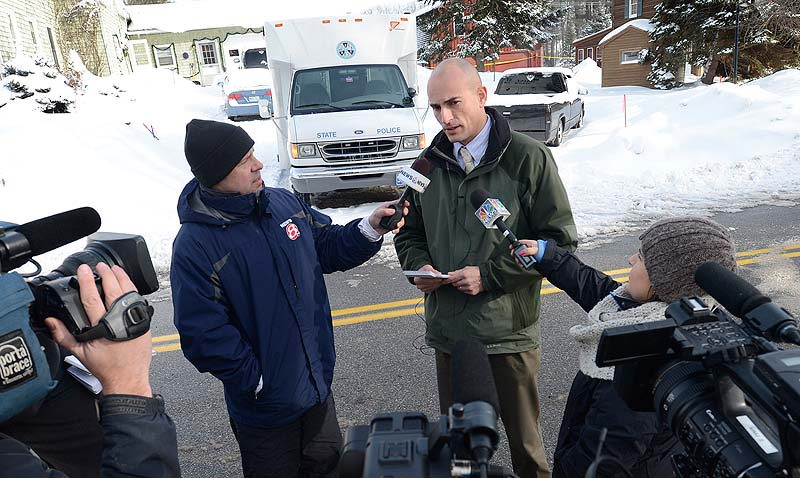 Maine State Police Sgt. Mark Holmquist speaks Sunday with reporters at the scene of a Saturday shooting at 17 Sokokis Road in Biddeford.