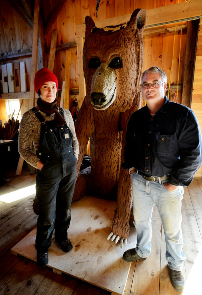 Arron Sturgis of Preservation Timber Framing in Berwick, with preservationist Jessica MilNeil, is working with the Ogunquit Museum of American Art to conserve a Bernard Langlais sculpture of a bear.