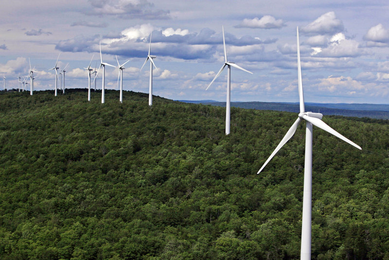 Wind turbines line a ridge on Stetson Mountain in Stetson. Proposed new wind power projects in Maine could get to market via a new transmission line that would require 150 miles of new wires and substations.