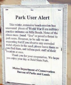 A 1997 sign aler ted Reid State Park visitors about possible World War II-era ordnance surfacing on the beach because of erosion.