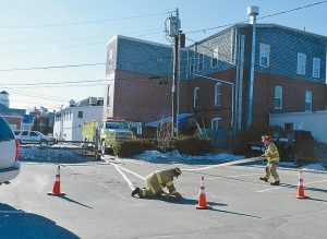 A BRUNSWICK FIRE DEPARTMENT crew works to remove water from Pedro O'Hara's restaurant.