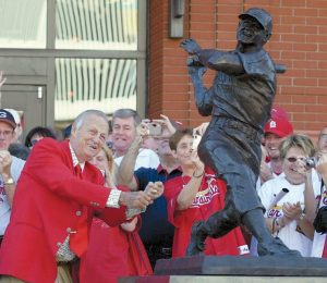 "IN THIS Oct. 1, 2006, file photo, St. Louis Cardinals great Stan ""The Man"" Musial strikes his signature pose after unveiling his statue at the re-dedication ceremony for the statues, at the new Busch Stadium, of Cardinals Hall-of- Famers and notables before a baseball game against the Milwaukee Brewers in St. Louis. Musial, one of baseball's greatest hitters and a Hall of Famer with the St. Louis Cardinals for more than two decades, died Saturday, the Cardinals announced. He was 92."