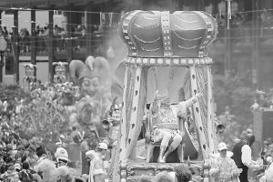 """IN THIS FILE PHOTO, Rex, the King of Carnival rides in the Krewe of Rex as he arrives at Canal St. on Mardi Gras day in New Orleans. With the Super Bowl in New Orleans Feb. 3 and Mardi Gras falling just nine days later, the city is gearing up for a massive celebration and influx of tourists that locals are calling """"Super Gras."""""""