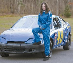 IN THIS NOV. 14, 2012, photo, Michelle Leh, 13, of Montague, Mass., poses with her stock car.