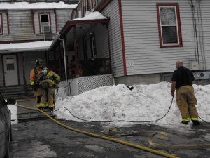 Brunswick firefighters extinguish a blaze at a five-unit apartment house at 23 Oak St. that severely injured a 53-year-old man.
