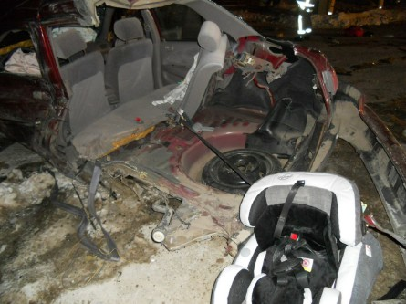 The 1999 Toyota Corolla being driven by Chynna Blaney was destroyed in a collision with a large pickup Thursday evening, and the impact ripped off the rear quarter of the car, dislodging the infant seat that Blaney's 6-month-old was using.