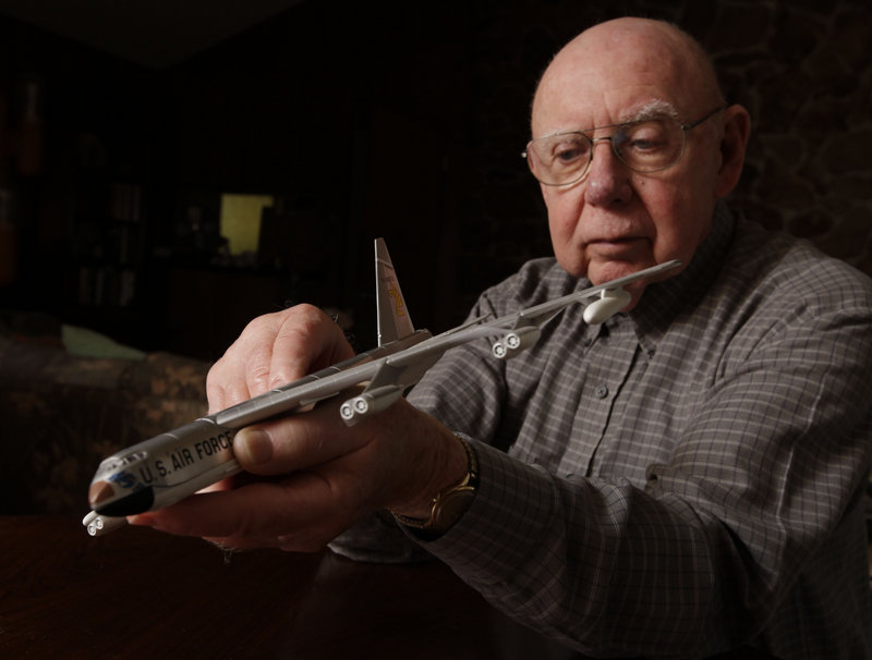 Gerald Adler, the navigator of a B-52 that crashed in remote Maine woods in 1963, holds a model of the legendary bomber at his home in Davis, Calif.
