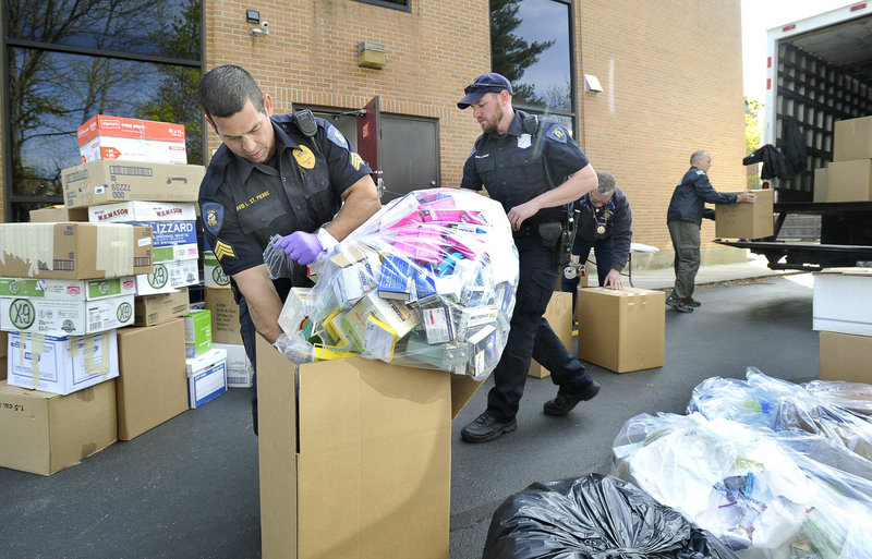 Lewiston Police Sgt. David St. Pierre and Officer Craig Johnson crate unused prescription drugs at the U.S. Drug Enforcement Administration's Portland office April 28, 2012, during National Prescription Drug Take-Back Day.