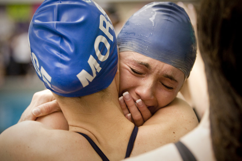 "Celia Ouellette of Mt. Ararat shows her emotions after setting a state record in the 50-yard freestyle at the Class A girls' swimming championships at Bowdoin College, Ouellette was timed in 23.84 seconds. ""I'm so happy,"" she said."