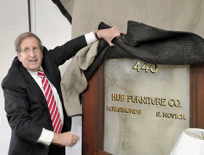Sam Novick shows a door to Hub Furniture from the 1920s when it was located on Congress Street.