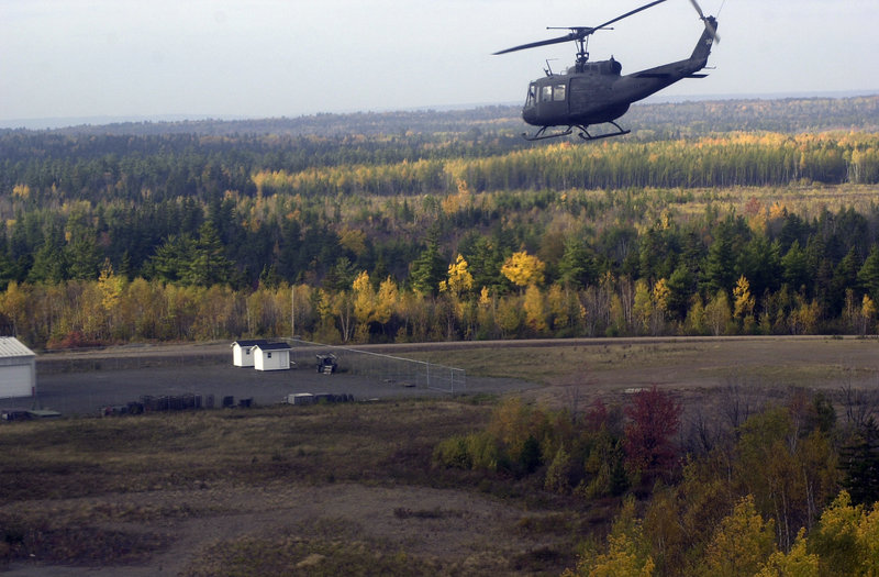 A Maine Army National Guard helicopter approaches the base.