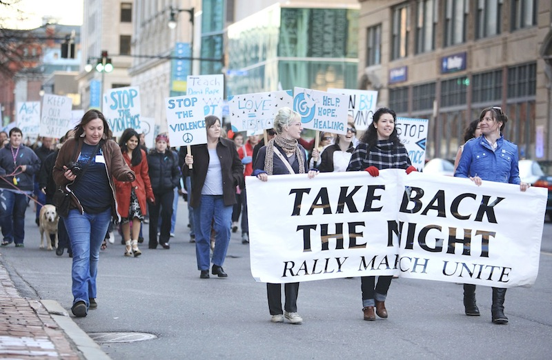 Participants at the 'Take Back the Night' march and rally make their way down Congress Street following speeches and songs at Monument Square in Portland Friday, April 26, 2013.