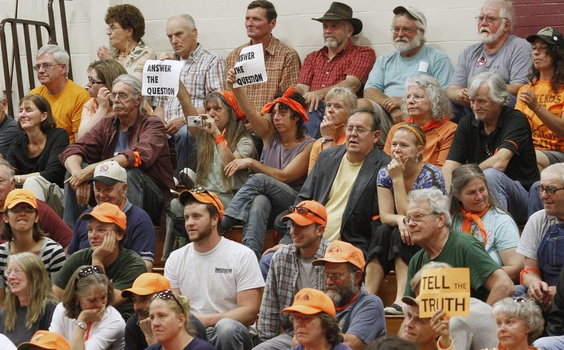 A group responds to Peter Vigue, CEO of Cianbro Corp., while he addresses more than 700 people during a public meeting at Foxcroft Academy in Dover-Foxcroft on May 31, 2012, to discuss the proposed east-west corridor. A study on the project's feasibility will cost Maine taxpayers $300,000, although Vigue says the project will be privately financed.