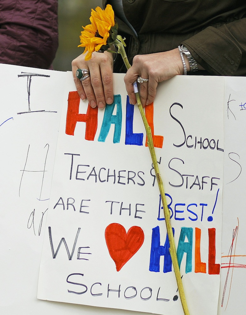 Gloria Noyes, a teacher at the Fred P. Hall Elementary School holds a sign made by one of her students at a rally Thursday, May 2, 2013, held to protest the grade of F given the school by the LePage administration.