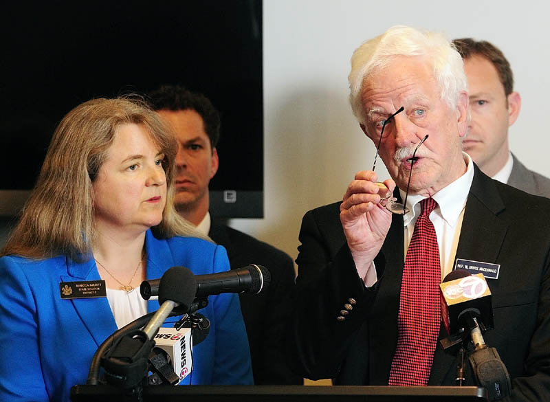 The co-chairs of the Legislature's Education Committee – Sen. Rebecca Millett, D-Cape Elizabeth, and Rep. Bruce MacDonald, D-Boothbay, introduce a Democratic plan to evaluate schools during a news conference on Wednesday at the State House.